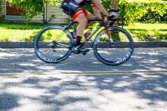 Bicycle Racer Speeding Past Royalty Free Stock Photo