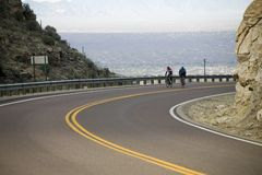Bicycle racers. In training on mountain road above Tucson, AZ Stock Images