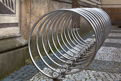 Bicycle rack made of stainless steel. Stainless steel bicycle rack in the city of Prague Stock Images
