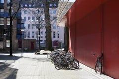 Bicycle rack near apartment block Stock Images