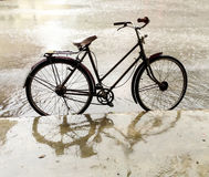 Bicycle in the rain. Bicycle park at footpath in the rain Stock Images