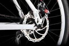 Bicycle rear disc brake. Studio shot of bicycle rear disc brake on black background Royalty Free Stock Images