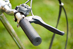 Bicycle recreation device grip and skid. On grass Stock Photo