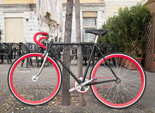 Bicycle. With red chain locked in the park stock photography