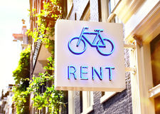 Bicycle rent sign of a bicycle shop. Building exterior of a bicycle rental shop in the sunlight royalty free stock images