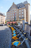 Bicycle rental in front of an hotel in Brussels. Brussels, Belgium - July 31, 2015: Bicycle rental in front of an hotel in Brussels, nearby the central station stock photography