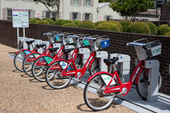 Bicycle Rental Station Bikes. AUSTIN, TEXAS - AUGUST 23, 2015: Bicycles can be rented by the hour for touring around the city at the B-cycle Station kiosk in Royalty Free Stock Photo