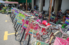 Bicycle renting service available in the street art in Georgetown, Penang Stock Photo