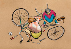 Bicycle repair. Two boys work at wheels Royalty Free Stock Images