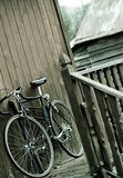 Bicycle at rest. A bicycle resting up against the side of a house Stock Image
