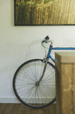 Bicycle resting against an indoor wall