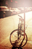 Bicycle resting at the street Royalty Free Stock Photos