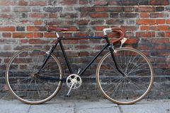 Bicycle. Retro/vintage bicycle and red wall. Road bike and red wall Stock Image