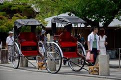 Bicycle rickshaw for Japanese people and traveler foreigner sit. Tour around arashiyama city on July 12, 2015 in Kyoto, Japan stock photography