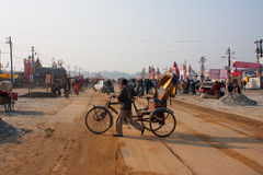 Bicycle rickshaw turns in the camp at Sangam Royalty Free Stock Images