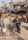 Bicycle rickshaw in Varanasi. A man is standing with his bicycle rickshaw in the city of varanasi Royalty Free Stock Photography