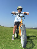Bicycle ride. Pic of a boy ready to ride his bicycle stock photography