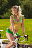 Bicycle ride. Girl with bicycle in the park Royalty Free Stock Photo