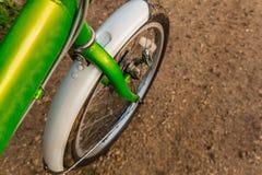 Bicycle ride through muddy dirt road Royalty Free Stock Photos