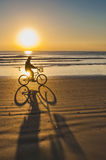 Bicycle Ride at Sunrise on Cocoa Beach Stock Photography