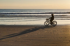 Bicycle Ride at Sunrise on Cocoa Beach royalty free stock photo