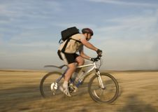 Bicycle Rider#2. Panning shot of a bike rider with rural background Stock Photography