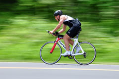 Bicycle Rider. Panning shot of a man riding his bicycle on Skyline Drive in Virginia, USA. The person is cycling for self recreation Stock Images