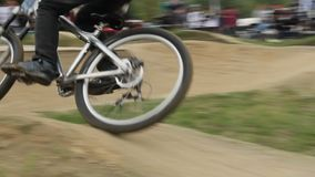Bicycle rider BMX races difficult track, spinning wheels daytime. Stock footage stock video footage