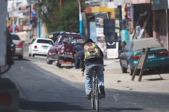 Bicycle rider in Chimaltenango. Bicycle rider on side of road in chimaltenango, Guatemala, Central America Royalty Free Stock Images