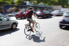 Bicycle rider in city traffic Royalty Free Stock Image