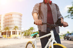 Bicycle rider. Cropped image of guy with bicycle on sunny day Stock Photo