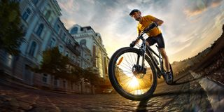 Bicycle rider cycle in city street fish eye view royalty free stock images