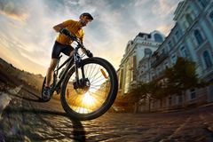 Bicycle rider cycle in city street fish eye view royalty free stock image