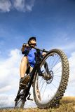 Bicycle rider on the hill Stock Photography