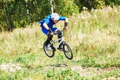 Bicycle rider making high jump on bike Royalty Free Stock Image
