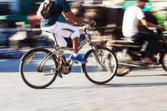 Bicycle rider in motion blur Royalty Free Stock Photos