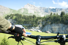 Bicycle rider navigates in mountains Stock Photography