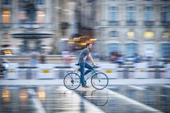 Bicycle rider rushes through the streets