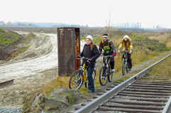 Bicycle riders go along the railroad Stock Image
