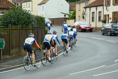 Bicycle riders training on town road royalty free stock photos