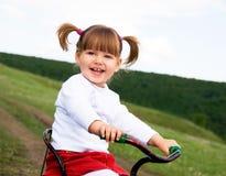 bicycle riding девушки Стоковые Изображения RF