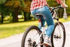 bicycle riding девушки Стоковые Изображения