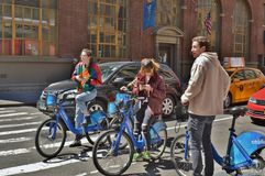 Millennials riding CitiBikes stock images
