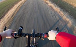 Bicycle riding on country road Stock Photos