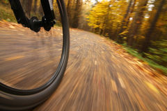 Bicycle riding, low angle motion blur stock photo
