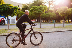 Bicycle riding male. In black sportswear and sunglasses Royalty Free Stock Photography