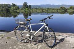Bicycle by the river - on the fishing Royalty Free Stock Photo