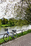 Bicycle at Riverside. A Bicycle parked at a beautiful and peaceful riverside in Bremen Stock Images