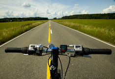Bicycle on road Royalty Free Stock Images