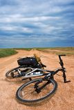 Bicycle on a road. Bicycle on a sandy road royalty free stock image
